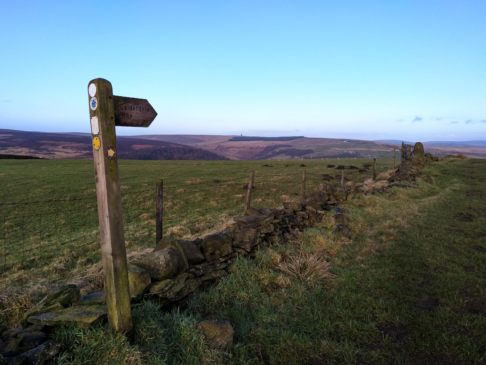 Calderdale Way footpath sign with Stoodley Pike monument in the distance